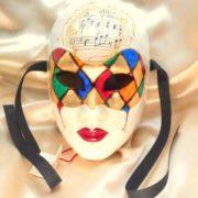volto donna maschera arlecchino e musica