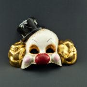 pagliaccio in foglia d'oro con cappello nero